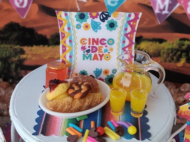 cinco de mayo breakfast with pastries and orange juice