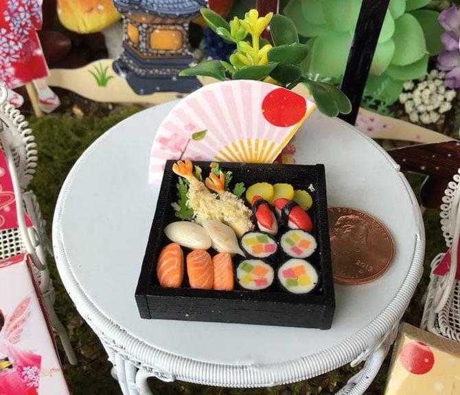 iaada international fairy's sushi in a black bento box and pink fan, miniature sushi