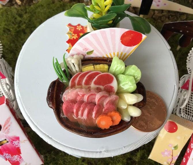 iaada's miniature japanese hot pot dish, sukiyaki in a shiny bowl, pink fan