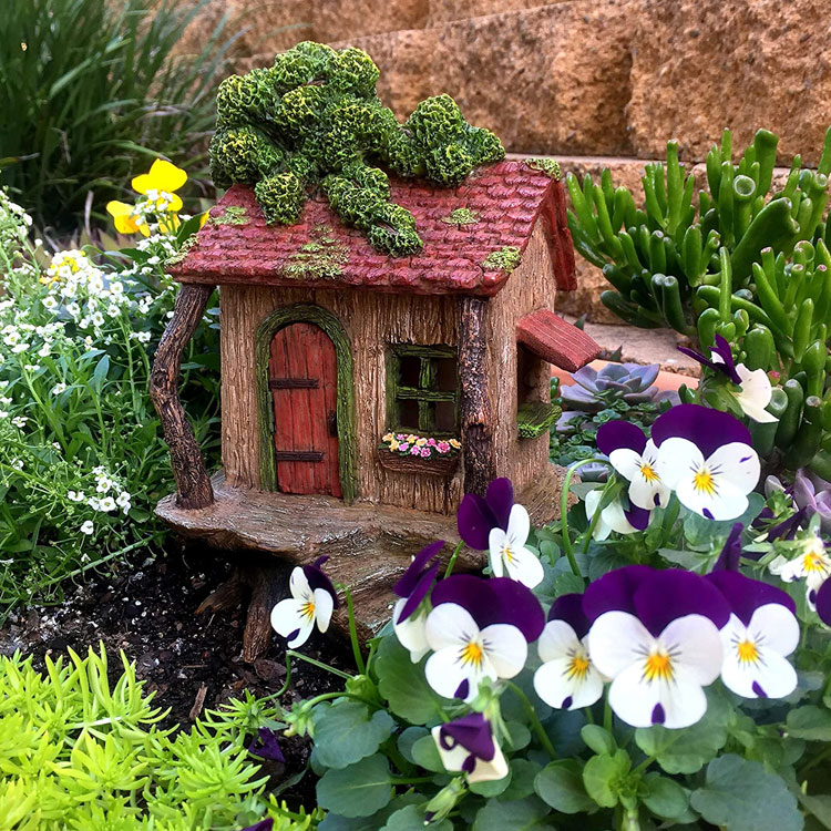 large fairy tree house with a door that opens