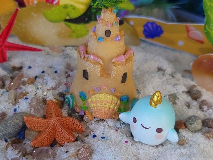 mermaid beach sand castle with blue baby unicorn whale