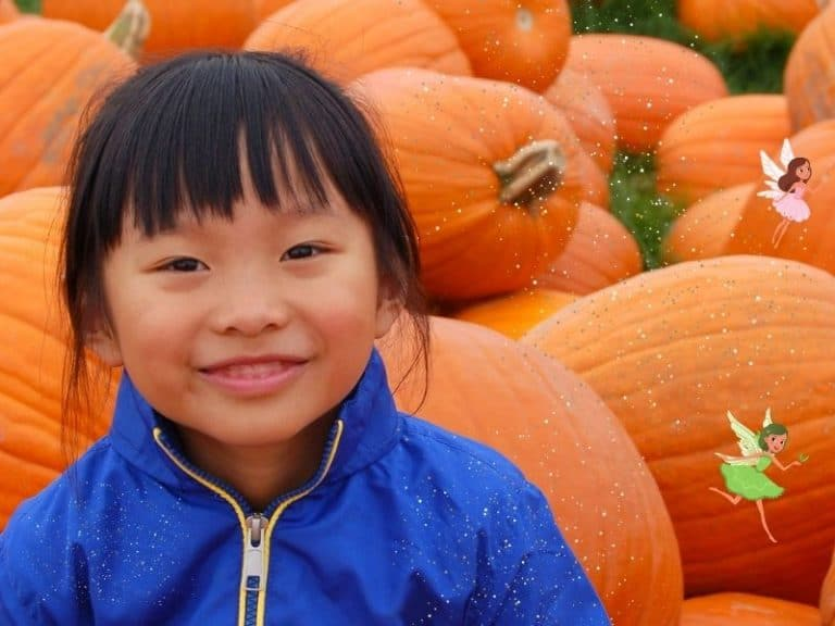 girl in pumpkin patch